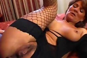 older bitch in fishnets takes dark dick
