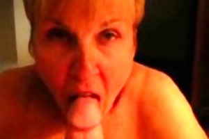 older lady engulfing cock