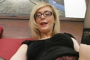 golden-haired housewife in glasses licking