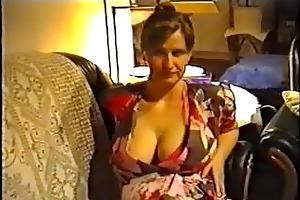wife flashing big meatballs in a brassiere