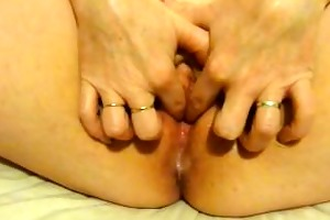 wife plays with her moist vagina after