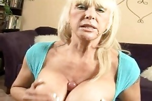tanned blond momma with giant hooters doing titjob