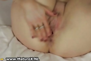 excited golden-haired older housewife widening