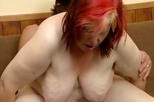 naughty overweight woman receives her curly wet