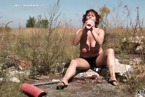 bawdy aged whore playing with her massive