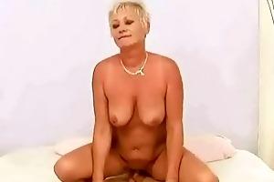concupiscent breasty grandma seducing a guy