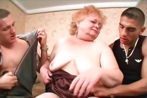 mature honey engulfing two big schlongs