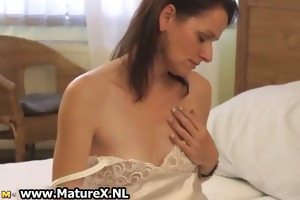 excited dark brown housewife enjoys rubbing