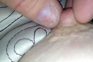 pulling &; twisting her ripe teat until she