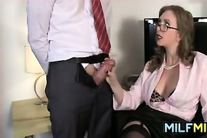 mother i giving a handjob at the office