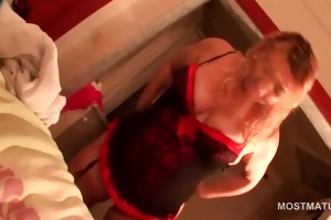 busty aged playing with her hot assets in ottoman