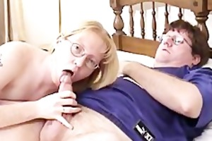 golden-haired mother i wearing glasses blows and