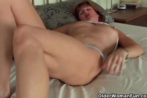 older redheaded mamma masturbates with sex toy