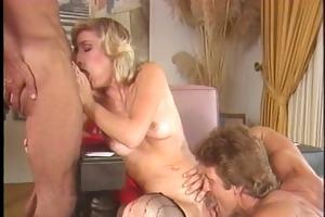 older golden-haired receives dick in her throat