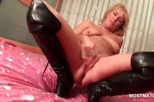 older in leather boots doing herself in couch