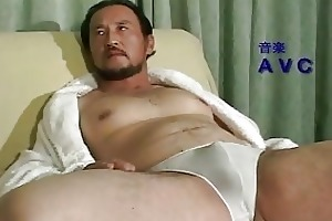 older oriental chap all alone at home