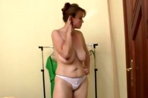 hawt older woman takes two knobs at once