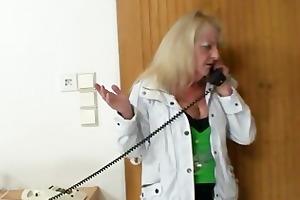 golden-haired grandma in dark nylons copulates