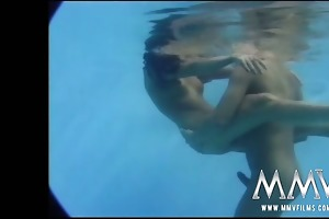 sexy dark brown having erotic wet sex in the pool