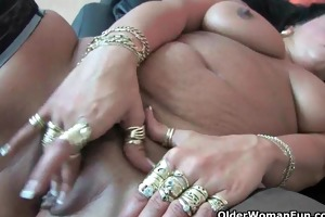 sleazy mammas in corset and nylons having solo sex